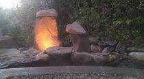 rock outcropping with landscaper lighting in king county