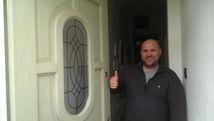 Locksmith in Gateshead, man standing at door, fixing door