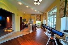 Kitchen design, lighting, hardwood floors and custom wall coverings