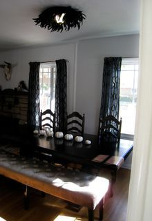Residential dining room includes custom table and chairs, flooring, and art work