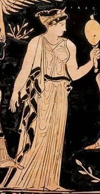 Woman of Ancient Greece looking in golden Mirror