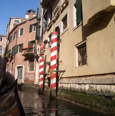 "rc=""australian womens tours.jpg alt=womens travel, canal with striped boat poles, venice"">"
