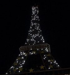 "src=""australian womens travel.jpg alt=womens travel, small lights on eiffel tower, paris france """