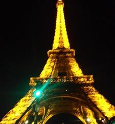 "src=""australian womens travel.jpg alt=womens travel,eiffel tower at night with green light , paris france """