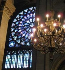 "src=""australian womens travel.jpg alt=womens travel,rose window and chandelier, notre dame , paris france """