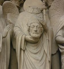 "src=""australian womens travel.jpg alt=womens travel,st denis holding his head, notre dame , paris france """