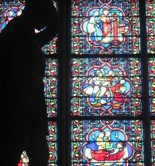 "src=""australian womens travel.jpg alt=womens travel,silhoette fo statue and stained glass window, notre dame , paris france """