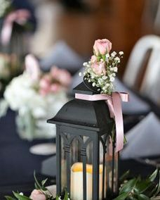 Lantern with blush spray roses and baby's breath