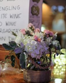 centerpiece with blush roses, silver bruin berries and dusty miller