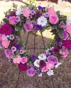 funeral heart with purple and pink flowers