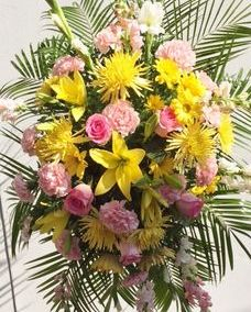 yellow and pink funeral spray