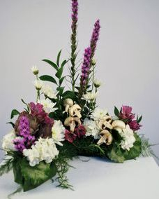urn floral piece with fresh mushrooms