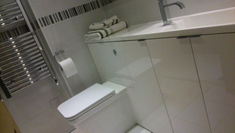 bathroom, leds, tiled floor and fitted furniture