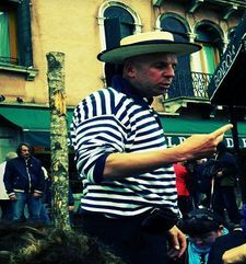 "womens tours.jpg alt=womens travel, gondalier with straw hat, venice"">"