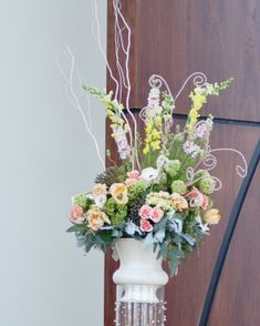 Church wedding floral arrangement with pastel flowers