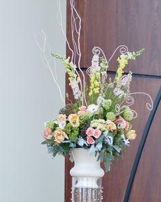 Church wedding floral arrangement with pastel flowers