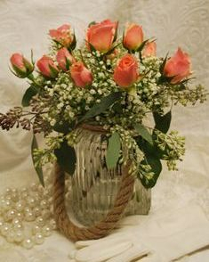 Vintage floral arrangement with ilse spray roses