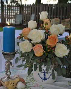 Nautical floral arrangement with peach and white flowers