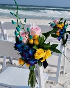 Bom Blue dendrobium orchids with yellow spray roses