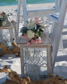 Vintage lantern with white ranunculus and pink astilbe
