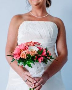 Coral gerber daisy bouquet with coral marline roses