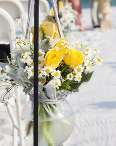 Hanging beach arrangement with yellow and white flowers