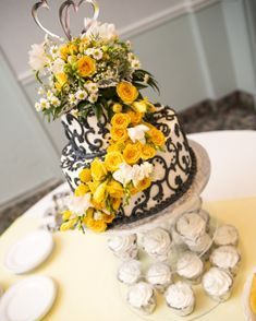 Wedding cake flowers with yellow roses and craspedia