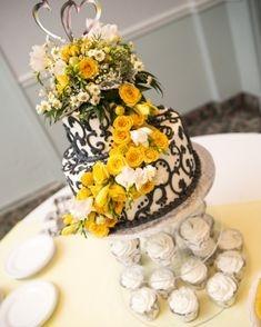 Wedding cake flowers with yellow roses and craspedia