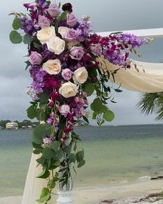 Corner arbor flowers with garden roses, stock and purple roses