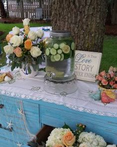 Rustic Dresser with peach and white flowers
