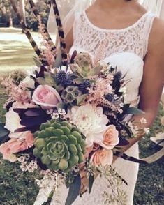 Wildflower bridal bouquet with pheasant feathers