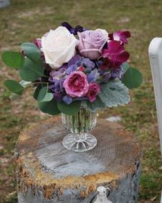 Pedestal flowers with purple roses and white Ohara garden roses