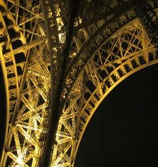 "src=""australian womens travel.jpg alt=womens travel,steelwork detail eiffel tower at night , paris france """