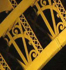 "src=""australian womens travel.jpg alt=womens travel,eiffel tower detail in yellow light , paris france """