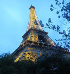"src=""australian womens travel.jpg alt=womens travel,looking up at the eiffel tower at dusk , paris france """