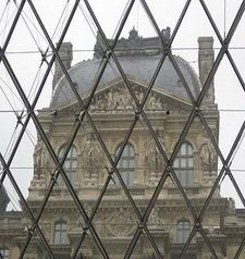 "src=""australian womens travel.jpg alt=womens travel,looking out through glass pyramid, louvre , paris france """