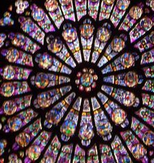 "src=""australian womens travel.jpg alt=womens travel,detail of rose window, notre dame , paris france """
