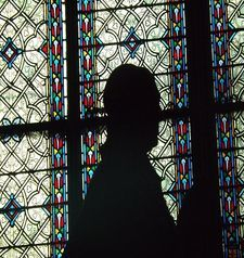 "src=""australian womens travel.jpg alt=womens travel,interior stained glass window and statue, notre dame , paris france """