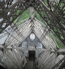 "src=""australian womens travel.jpg alt=womens travel,looking down on the steel work at the eiffel tower , paris france """
