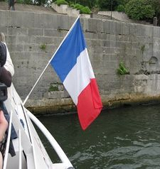 "src=""australian womens travel.jpg alt=womens travel,french flag on the back of boat , paris france """