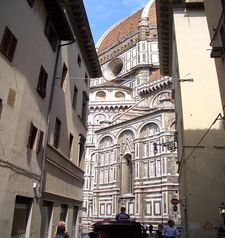 "womens tours.jpg alt=womens travel, streetscape including the duomo, florence"">"