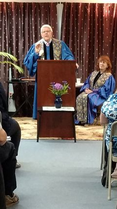 Rev. Jim DeBiasio, founding Pastor of the Institute for Spiritual Development presents the chartering service for Oneonta Chapter, June 3, 2017