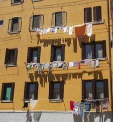 "<img src=""australian womens travel.jpg alt=womens travel,washing hanging out of homes in the back streets of venice"">"