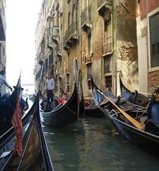 "womens tours.jpg alt=womens travel, three gondolas in quiet canal, venice"">"