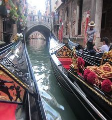 "womens tours.jpg alt=womens travel,gondaliers with red cushions, venice"">"