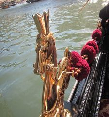 "womens tours.jpg alt=womens travel, gold gondola decoration and red tassles, venice"">"