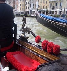 "womens tours.jpg alt=womens travel, gondola with red seat and pom poms, venice"">"
