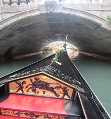 "womens tours.jpg alt=womens travel, gondola heading towards bridge, venice"">"