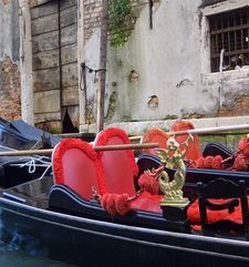 "womens tours.jpg alt=womens travel, gondola with beautiful red chairs, venice"">"