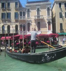 "womens tours.jpg alt=womens travel, gondolier steering gondola, venice"">"